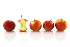 Apple core among whole apples Royalty Free Stock Image