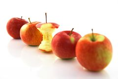 Apple core among whole apples, focus on the core. Apple core among whole apples, with focus on the core Stock Photos