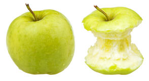 Apple core and whole granny smith Royalty Free Stock Image