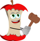 Apple core with a wooden hammer Royalty Free Stock Photo