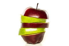 Apple cortou seções no fundo branco Fotografia de Stock
