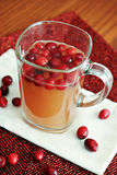 Apple Cranberry Cider. Apple cider with fresh cranberries Stock Photo