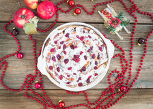 Apple, cranberry and cinnamon roll cake with creamy icing and Ch Stock Images
