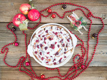 Apple, cranberry and cinnamon roll cake with creamy icing and Ch Stock Photography