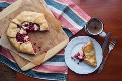 Apple and Cranberry Galette. Autumn dessert cranberry galette with apple and coffee Stock Photography