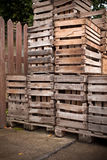Apple crates stacked up Stock Photos