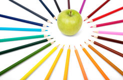 Apple with crayons Stock Image