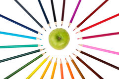 Apple with crayons Royalty Free Stock Photos