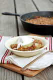 Apple Crisp. Skillet apple crisp with ice cream royalty free stock photos