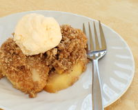 Apple crisp. Delicious apple crisp dessert with vanilla ice cream stock images