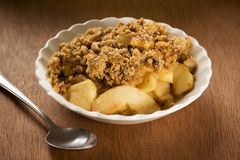 Apple Crisp or Apple Crumble in a Bowl. Apple Crisp or Apple Crumble is a dessert made with sliced apples topped with a brown sugar crust stock photo