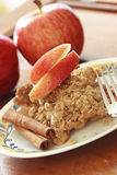 Apple crisp with apple slices. Photo of apple crisp dessert with apple slices with cinnamon sticks stock image