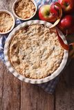 Apple crisp close-up in baking dish, vertical top view Royalty Free Stock Photo