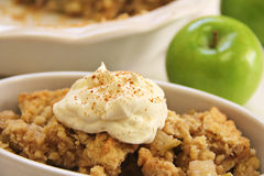 Apple crisp upclose whipped cream cinnamon Royalty Free Stock Image