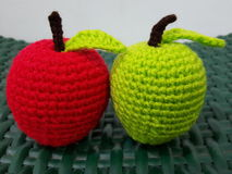 Apple Crochet. 2 apples Crochet one green one red on the green chair Stock Images