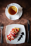 Apple croissant and black tea with lemon Royalty Free Stock Image
