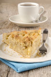 Apple crumb cake on a plate. Apple crumb cake and fork on a plate royalty free stock photo