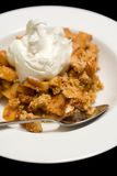 Apple Crumble. Dessert, isolated against black background Royalty Free Stock Images