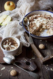 Apple crumble with almonds on rustic table with wood frames Stock Images