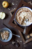 Apple crumble with almonds on rustic table with wood frames and spoons Royalty Free Stock Photos