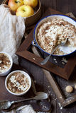 Apple crumble with almonds on table with wood frames, whole apples and cloth Royalty Free Stock Image