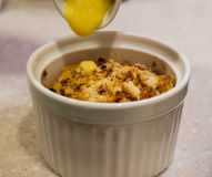 Apple Crumble with Custard Cream Stock Image