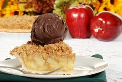Apple crumble dark chocolate ice cream and fork Stock Photos
