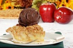 Apple crumble dark chocolate ice cream and fork Stock Photos