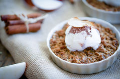 Apple Crumble Dessert With Cinnamon And Vanilla Ice Cream On Wooden Background stock photos