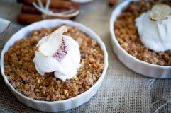 Apple Crumble Dessert With Cinnamon And Vanilla Ice Cream On Wooden Background stock photo