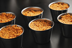 Apple crumble dessert in small steel pans royalty free stock photo