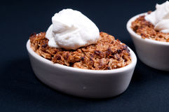 Apple crumble dessert. With whipped cream Stock Photography