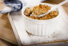 Apple Crumble Dessert on white wooden board. Stock Photo