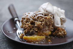 Apple crumble. Homemade rustic apple crumble with cream stock photo