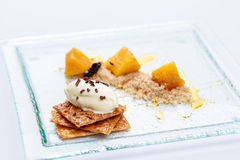 Apple crumble with ice cream royalty free stock photography
