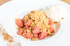 Apple crumble. With Icecream and cinnamon powder Royalty Free Stock Photography