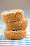 Apple crumble pie. Three small apple crumble pies stacked together stock images