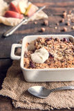 Apple crumble. Sweet homemade apple crumble in bowl,selective focus royalty free stock image