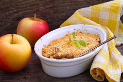 Apple crumble in a white bowl Stock Images