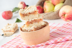 Apple crumble in wooden bowl Stock Image