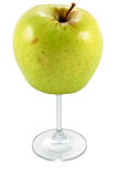 Apple cup. Concept of health and wholesome drink through a glass of apple cut and isolated Royalty Free Stock Image