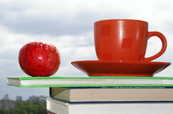 Apple, cup and books stock photo