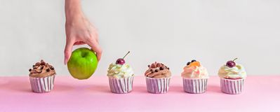 Apple and cupcakes on line royalty free stock image