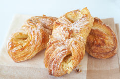 Apple custard filled croissants. On a brown napkin Royalty Free Stock Photography