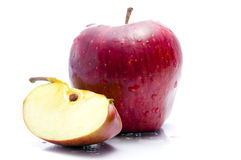 Apple With Cut. A Full & A Cut Apple Stock Photo