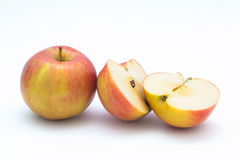 Apple cut in half. On white background stock photography