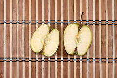 Apple cut in 2 halfs royalty free stock photo