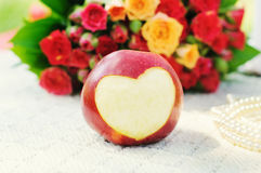 Apple with the cut out heart Stock Image
