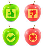 Apple cut out symbols. Red and green apple cut out: thumbs up, thumbs down, check mark and red cross Stock Photography
