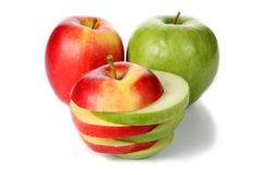Apple cut into slices Stock Photos